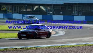 red bmw and bmw track car on track racing - lash photography