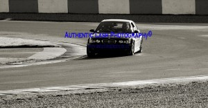 black and white image ,bmw on track - lash photograpy