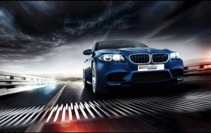 bmw specialist front view of blue bmw on road with dark clouds above