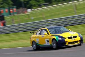 yellow motorsport car , racing track